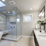 Large bathroom with a walk in shower and a bath tub.