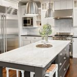 Marble top island in a kitchen.